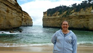 Having my photo taken at Loch Ard Gorge on the Great Ocean Road